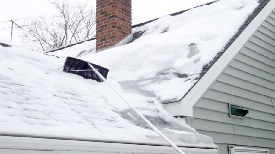 roof rake on snow-covered roof